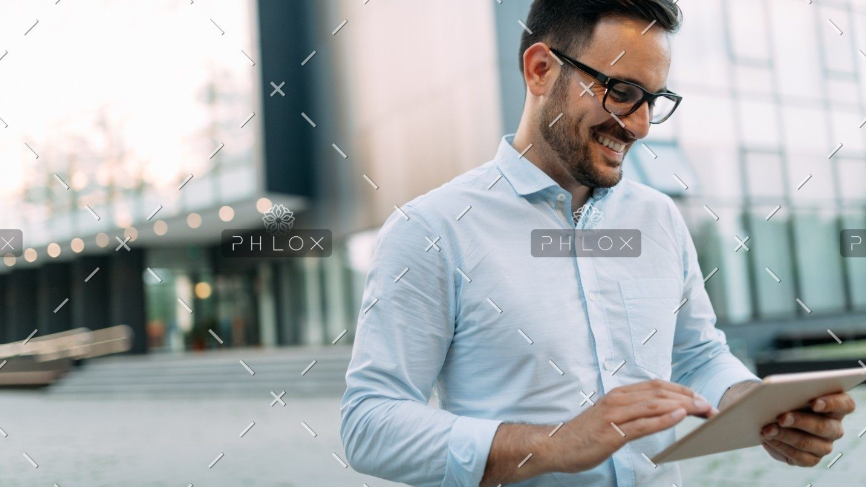 demo-attachment-609-portrait-of-businessman-in-glasses-holding-tablet-AWVHCJU